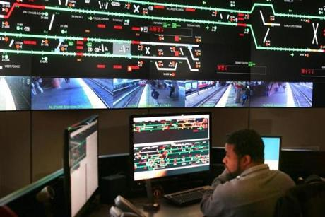 Inside the MBTA's Operations control room in downtown Boston where a dispatch team was able to bring the runaway train to a stop. A dispatcher monitored the red Line trains and the far left monitor showed the Braintree T Station stop.